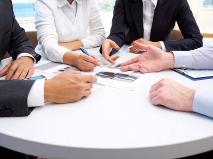 20151002170856-controllers-business-people-working-papers-meeting