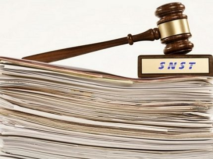 gavel on stack of documents on white background