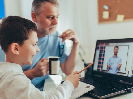Schoolboy educate online. Father helps his son with home work. Boy in video conference with teacher on laptop at home.  (Schoolboy educate online. Father helps his son with home work. Boy in video conference with teacher on laptop at home. , ASCII, 12